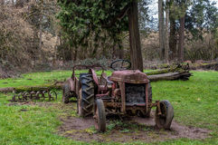 Ford Tractor. A rusty old Ford tractor rusting away in a field Stock Images