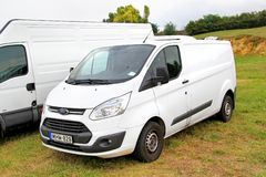 Ford Transit. BUDAPEST, HUNGARY - JULY 27, 2014: White cargo van Ford Transit at the grass field Stock Images