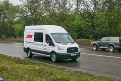 Ford transit. Krasnoyarsk, Russia - July 30, 2018: Ford Transit passing on the wet road to a rain royalty free stock image