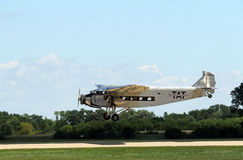 A Ford Tri-Motor Airplane lands at EAA AirVenture Stock Photo
