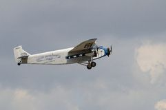 Ford Tri-Motor. A Ford Tri-motor in the livery of the old Eastern Airlines flies in a lightly clouded sky Stock Images