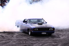 Ford V8 Ute doing a burnout Stock Images