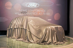 Ford veiled. GENEVA, SWITZERLAND - MARCH 1, 2016: New Ford model car still covered at the 86th International Geneva Stock Image