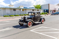Ford vintage car driving through the streets of Williams, Arizona Stock Image
