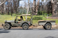 1943 Ford Willys Jeep driving on country road stock photos