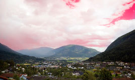 Forde town Norway. Scenic view of town of Forde under pink sky and cloudscape, Sunnfjord, Norway Stock Photos