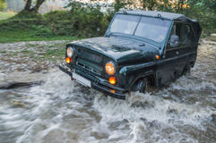 Fording a car through a river Stock Photo