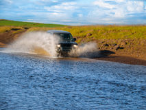 Fording offroad car Royalty Free Stock Photography