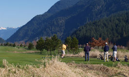 Fore. Golfers on the tee Royalty Free Stock Photography