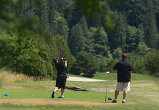 Fore. Golfer driving ball from the tee Royalty Free Stock Photo