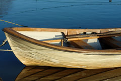 The fore of a boat. The fore of a small plastic rowboat in the water. Keel is weathered and dirty after years of use Stock Photography
