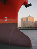 Fore of cargo vessel, houses in background. Fore of cargo vessel, with anchors, and buildings on background Stock Photos