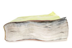 Fore edge of a book - texture or background. Clousep on the fore edge of a book damaged by water against white background Stock Photo
