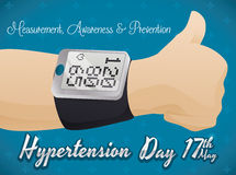 Forearm with Digital Sphygmomanometer and Thumb Up in Hypertension Day Royalty Free Stock Photo