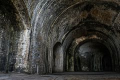 Foreboding brick interior passage inside Fort Pickens Stock Photography