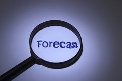 Forecast. Inscription word magnified under a magnifying glass Stock Image