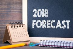 2018 forecast. paper calendar and chalkboard on a wooden table.  Royalty Free Stock Images