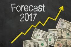 Forecast 2017. Text on blackboard with money - Forecast 2017 Royalty Free Stock Image
