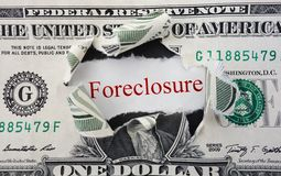 Foreclose. Foreclosure text in ripped dollar bill royalty free stock photos