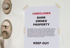 Foreclosed. Notice on a main door of a house stock photos