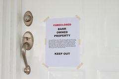 Foreclosed. Notice on a main door of a house Royalty Free Stock Photo