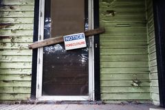 Foreclosed home. Old house with Foreclosure sign on the door Royalty Free Stock Photo