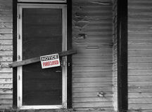 Foreclosed house notice. Boarded up house with Foreclosed notice on door Royalty Free Stock Photo