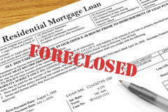 Foreclosed Stamped on Mortgage Document. A residential mortgage document with  a Foreclosure stamp Stock Photography