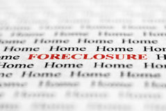 Foreclosure. Closeup detail of black and white words with red word of foreclosure Stock Images