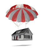 Foreclosure. Red and white vaned parachute suspended from a small, one level house protecting it from crashing.  House is isolated on white and just about to Royalty Free Stock Photography