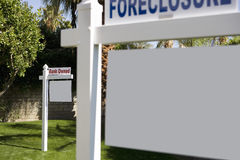 Foreclosure and Bank Owned signs in lawn Royalty Free Stock Photos
