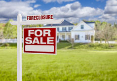 Foreclosure Home For Sale Sign in Front of Large House Stock Images