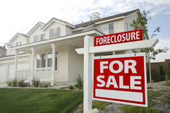 Foreclosure Home For Sale Sign and House stock photos