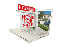 Foreclosure Home for Sale Sign & Laptop Royalty Free Stock Images