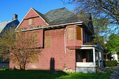 Foreclosure House. An abandoned foreclosed house with the Windows blinded royalty free stock photo