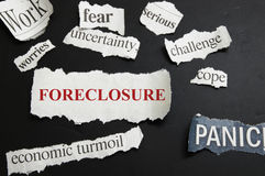 Foreclosure news. Newspaper headlines showing Foreclosure and bad economic news Stock Photography