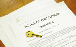 Foreclosure notice. Home foreclosure legal document with house key Stock Photography