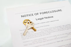 Foreclosure notice. Notice of Foreclosure document and house key stock images