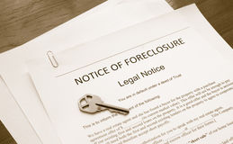 Foreclosure notice. Home foreclosure legal document with house key Royalty Free Stock Images