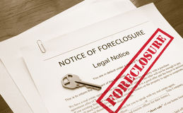 Foreclosure notice. Home foreclosure legal document with house key royalty free stock image
