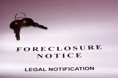 Foreclosure Notice. Set of house keys laying on a foreclosure notice Royalty Free Stock Images