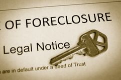 Foreclosure notice. Foreclosure legal notice and house key macro royalty free stock images
