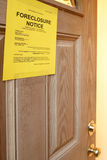 Foreclosure Notice. On door of home focus of sign Royalty Free Stock Photos
