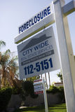 Foreclosure Real Estate Sign. Real estate signs at foreclosed property Royalty Free Stock Images