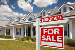 Foreclosure Real Estate Sign and House - Right. Foreclosure Home For Sale Real Estate Sign in Front of New House - Right Facing