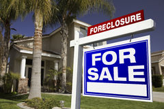 Foreclosure For Sale Real Estate Sign and House Royalty Free Stock Photo