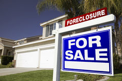 Foreclosure For Sale Real Estate Sign and House Stock Photos