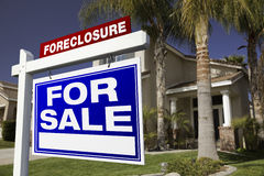 Foreclosure For Sale Real Estate Sign and House Royalty Free Stock Photography
