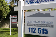 Foreclosure Sign. Closeup of real estate signs at foreclosed property Stock Image