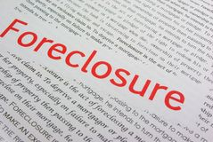Foreclosure. The word foreclosure in red type on a white background that contains the definition of the word Stock Photography